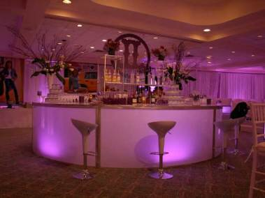 Pink-Full-rounded-illuminated-bar-with-scoop-stools-and-logo-cut-out