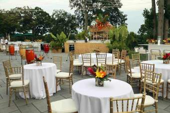 Tiki-bar-drum-cocktail-tables-bamboo-chairs-white-event-tables-and-floral-centerpieces