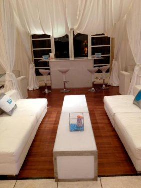 White-acrylic-bar-with-scoop-stools-and-privacy-booths