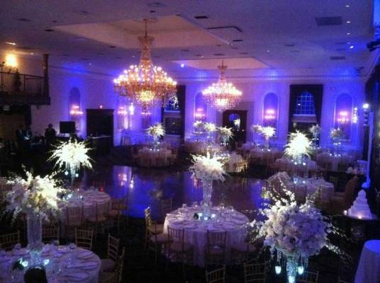 pinspot-lighting-over-giant-floral-centerpieces