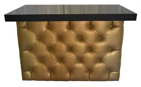 Gold tufted bar with black bar top