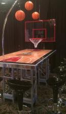 Basketball-Mitzvah-basketball-court-table-with-black-scoop-stools-and-basketball-hoop-centerpiece-with-backboard