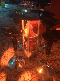 Basketball-Mitzvah-black-round-hi-table-with-basketball-filled-truss-stand-black-scoop-stools