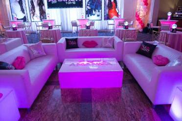 bat mitzvah furniture rental pink couches with lighted pink table