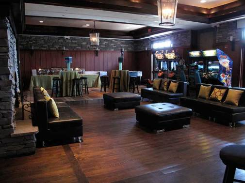 black-furniture-in-rustic-venue-with-pinball-machines