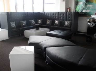 black-furniture-rentals-for-mitvah-hi-back-couch-and-personilized-pillows