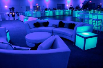 blue-mitzvah-curved-couches-customized-pillows-community-glow-tables-with-high-bar-chairs