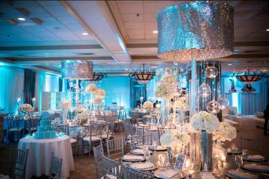 mitzvah-for-gabby-silver-centerpiece-chandeliers-with-fresh-flowers-crystal-orbs-and-round-tables