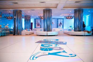 mitzvah-for-gabby-white-portable-dance-floor-with-logo-sticker-shimmering-drapes-and-white-furniture