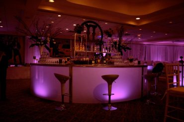 pink-mitzvah-illuminated-round-bar-with-scoop-seating-and-custom-centerpieces