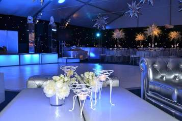 space theme bar mitzvah decor with floral centerpieces