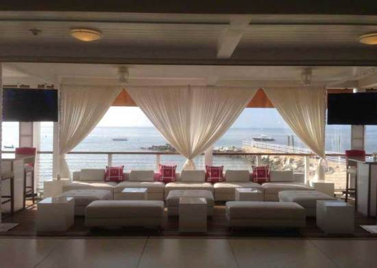 white-furniture-at-mitzvah-overlooking-the-water