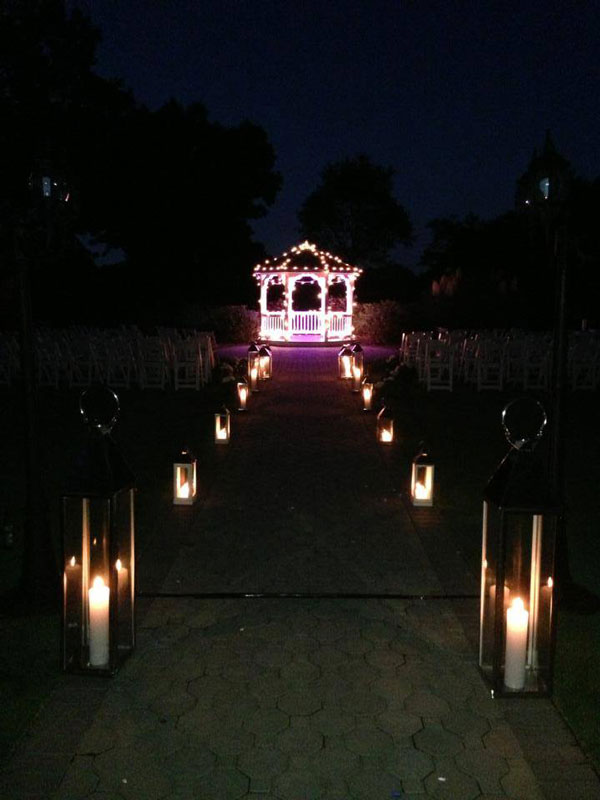 Candle-Hurricane-Lamps-Leading-to-Lighted-Gazebo
