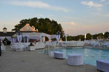 Country-Club-Event-Production-Tables-with-Seating-Palm-Tree-Prop-Privacy-Booths-and-Event-Furniture