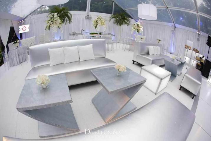 Silver Z shaped tables with silver lounge furniture and white accessories