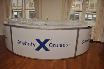Celebrity-Cruise-Corporate-Event-round-bar-with-logo-sticker-and-pyramid-of-glasses