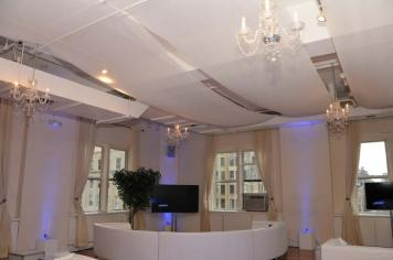 Celebrity-Cruise-Corporate-Event-with-ceiling-treatment-chandeliers-and-curved-couch