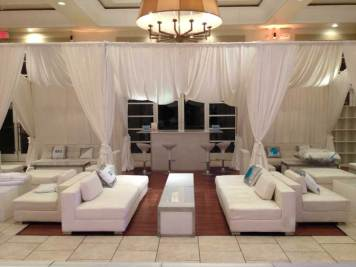 IGO-Corporate-Event-with-White-Louge-Decor-Illuminated-Tables-Draping-and-Bar-Stools