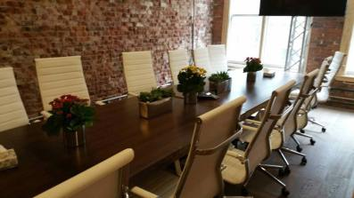 Country-flower-boxes-on-long-wooden-conference-table