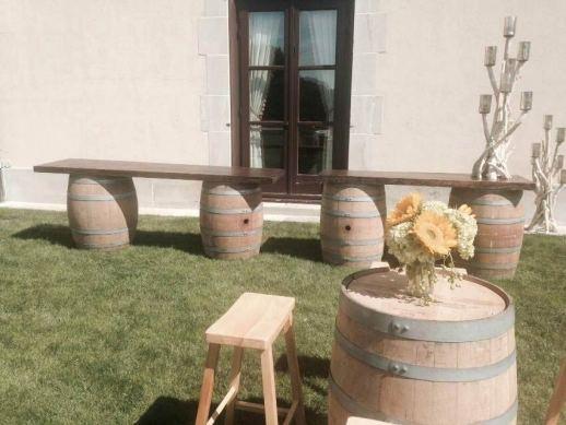 Rustic-barrels-with-wooden-tabletops-and-floral-centerpieces