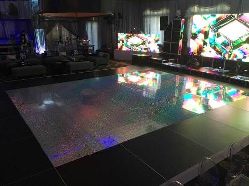 Holgraphic-dance-floor-with-video-wall-black-lounge-decor