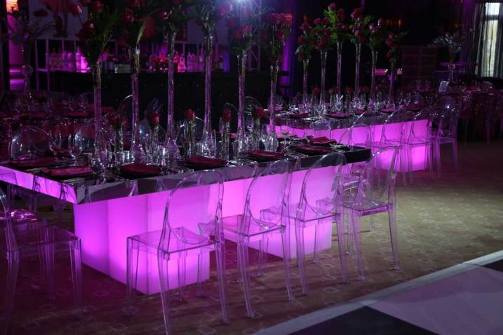 Mirrored-community-table-with-illuminated-stands-and-acrylic-chairs