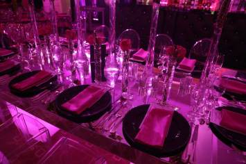 Mirroried-community-table-glass-centerpieces-ghost-chairs