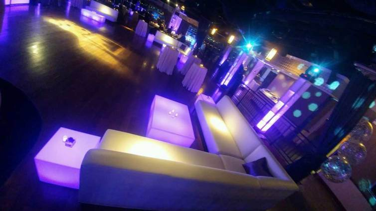 White-club-sofas-with-corners-and-illuminated-tables