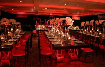 leather-covered-tables-with-bamboo-chairs-and-floral-centerpieces