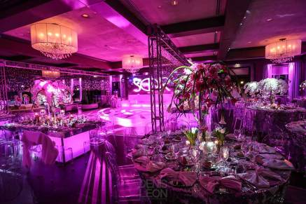 Bat-mitvah--event-decor-white-dance-floor-community-tables-with-centerpieces-paper-chandeliers