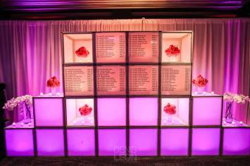 Led-cube-wall-with-floral-decoration-guest-list-table-setting-candles