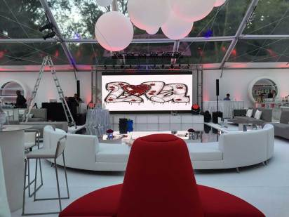 Sweet-sixteen-event-production-modular-furniture-couches-modern-colors-video-wall