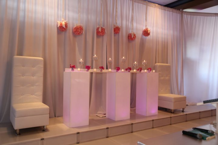 White-hi-back-lounge-seats-with-illuminated-high-boys-and-candle-centerpieces