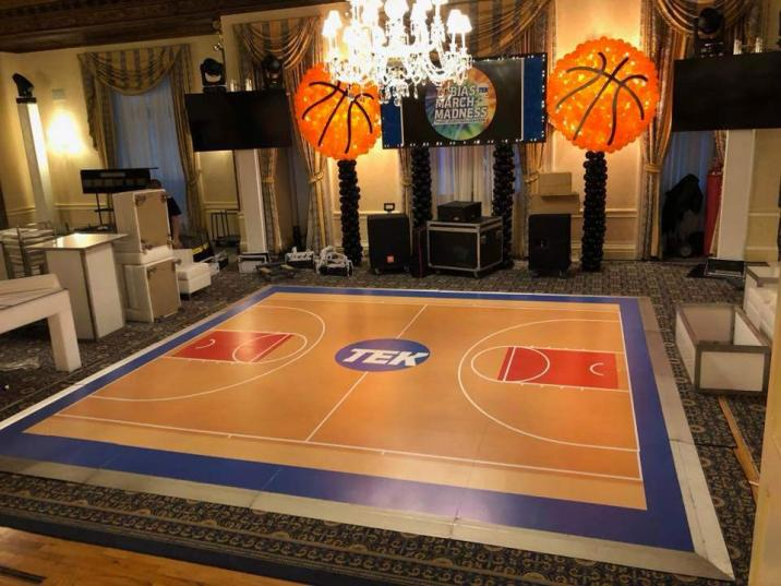 basketball court looking dance floor with basketball props for an sports themed party