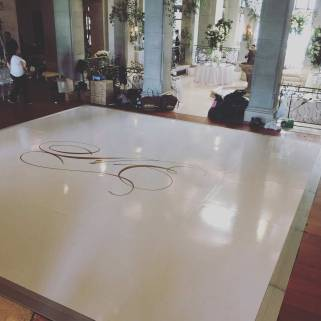 Portable-white-glossy-dancefloor-with-wedding-sticker-of-knot