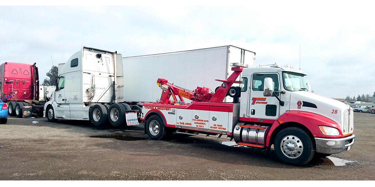 Heavy Duty Tow Truck pulling Big Rig