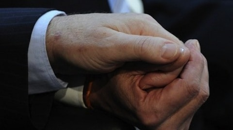 A-gay-couple-hold-hands-duing-their-wedding-ceremony-on-July-30-2010.-AFP