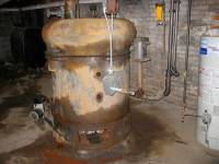 The old furnace, stripped of its protective asbestos. Seen