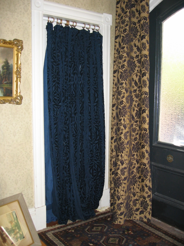 putting up curtains to hide a false door  Townhouse Turnaround