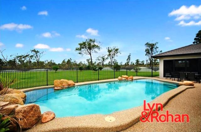 Pool View of 2 Raja Aho Road Rangewood Alice River photo from Remax Lyn and Rohan and featured by Townsville Real Estate News TREN eMagazine