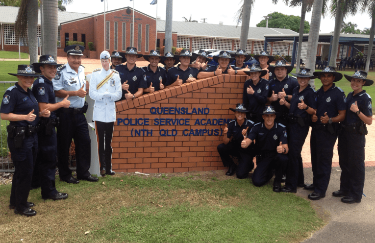 Police Academy - New recruits celebrating graduation at the Queeensland Police Academy in Townsville.