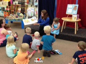 Amy reading a story at Story Time