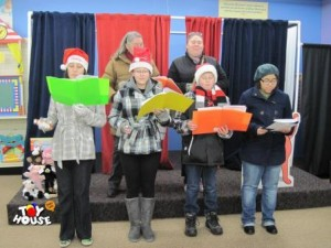 Christmas Carolers on the Stage at Toy House