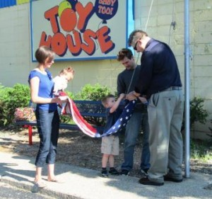 Family Raising the Flag at Toy House