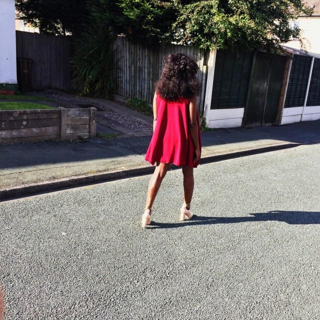 lady walking away in burgundy jacket