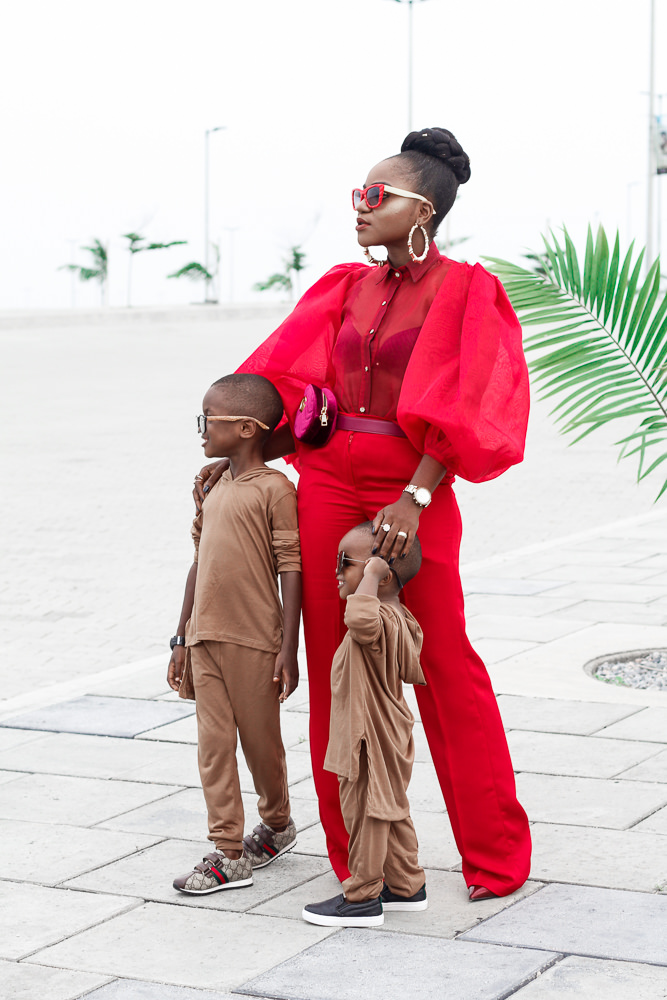heineken lagos fashion and design week 2017 , what i wore ,all red outfit ,styling all red ,fashion week style , lfdw street style ,bubble sleeve shirt,straight leg pant , gucci fanny pack , stylish mum and her boys