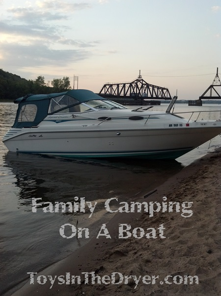 family camping on a boat
