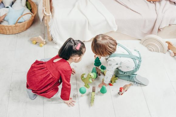 Two kids playing together and sharing toys. They are ready to play games for kids