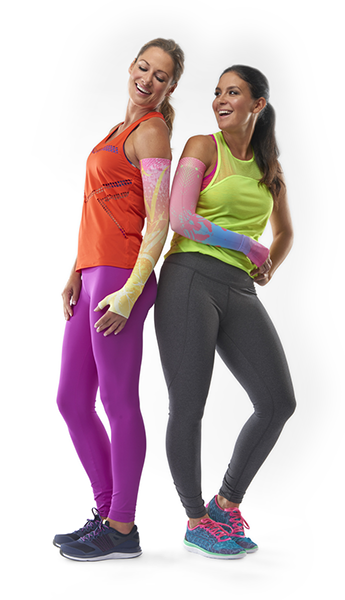 Two women in workout clothes wearing arm compression fittings.