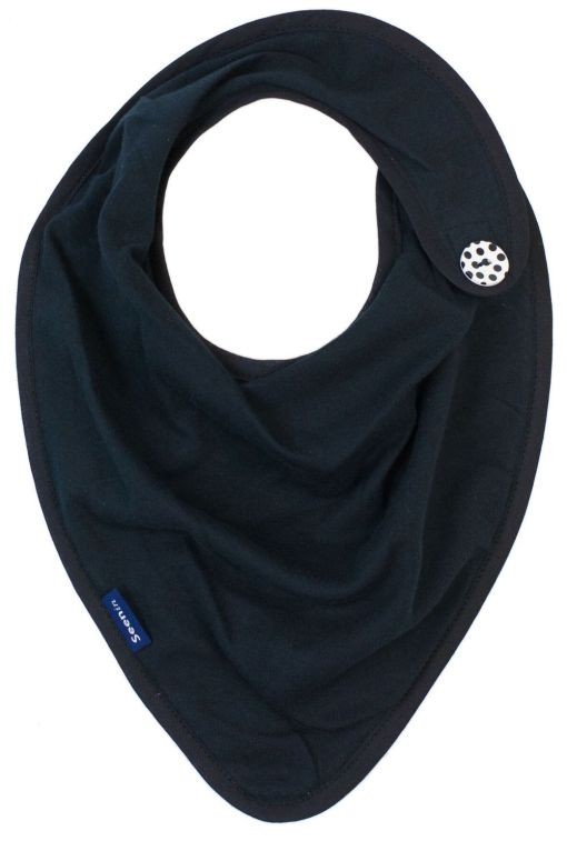 Image shows a photograph of a black kerchief with a black and white spotted button sewn on to one side.